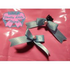 Tiny blue clasp bow
